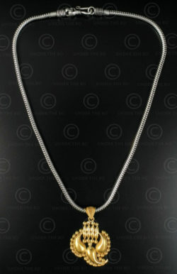 Gold pendant on silver chain 615. India.