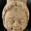 Indian statue C24. Stucco head of a cherub. South India.
