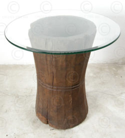 Side table H19-98. Teakwood curry pounders with glass top. India.