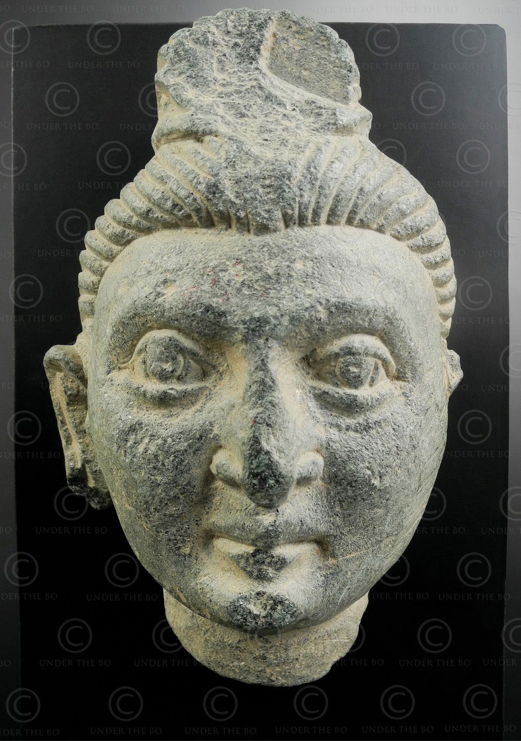 Gandhara schist Buddha face PK258. Greco-Buddhist art, ancient Gandhara kingdom, today Pakistan.