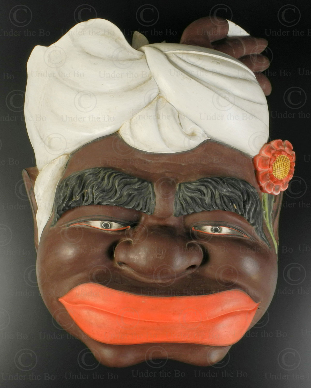 Balinese face sculpture ID83. Fro the Ambara workshop, Mas village, central region of Bali island, Indonesia.